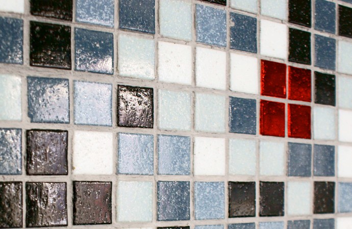 Black tiled wall with red bricks